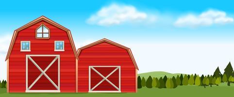 Scène de ferme avec des granges dans un champ