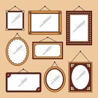 un mur de cadres de miroirs décorés vecteur