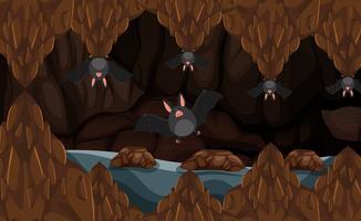 Cave souterraine avec chauves-souris vecteur
