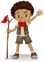 Un jeune scout vecteur