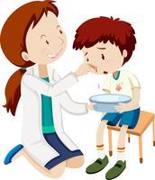 Un garçon saigne du nez vecteur
