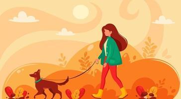 Femme marchant avec un chien dans un parc en automne vecteur
