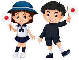 Garçon et fille tenant le drapeau du Japon vecteur