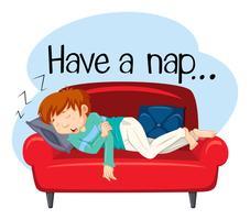 Un jeune homme ayant une sieste sur un canapé