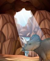 Triceratops vivant dans la grotte vecteur