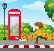 Un garçon promenant un chien