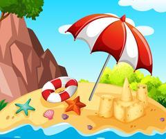 Scène de fond avec le château de sable sur la plage