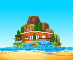 Un vecteur de maison devant la plage