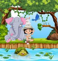 Girl scout avec des animaux dans la forêt