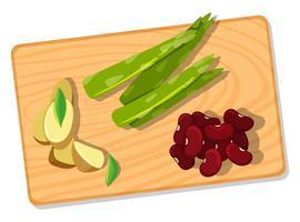 Légumes differnt sur planche à découper vecteur