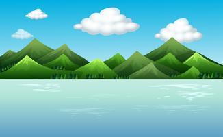 Scène de fond avec montagnes et lac