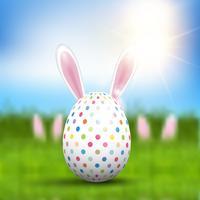 Oeuf de Pâques avec oreilles de lapin vecteur
