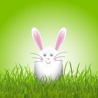 Joli lapin oeuf de pâques en herbe vecteur