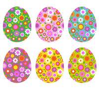 Oeufs de Pâques avec motifs floraux vecteur