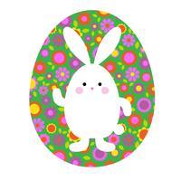 mignon lapin de Pâques sur oeuf de motif floral vert