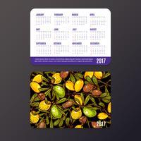 Calendrier de poche avec éco-produits, fruits et branches d'argan. vecteur