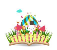 printemps d'oeuf de Pâques avec l'herbe et la floraison dans le livre