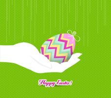 Joyeuses Pâques tenant un oeuf