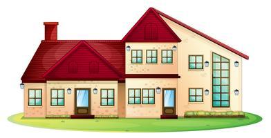 Maison au toit rouge avec pelouse verte vecteur