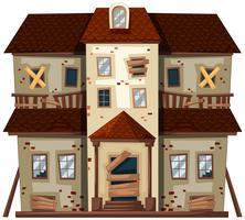Vieille maison aux vitres brisées