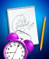 Retour à la conception de l'école avec réveil, crayon graphite et cahier