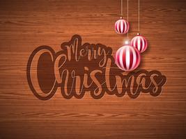 Joyeux Noël main lettrage Illustration avec étiquette en papier et des boules de verre ornementales rouges sur fond bois vintage. Conception de vacances vecteur EPS 10.
