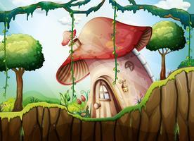 Maison champignon dans la forêt tropicale