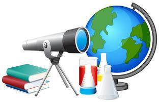Différents équipements scolaires avec télescope et globe