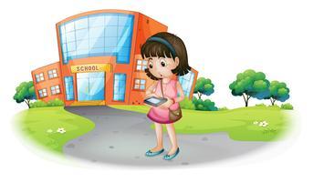 Une jeune fille textos devant un bâtiment de l'école vecteur