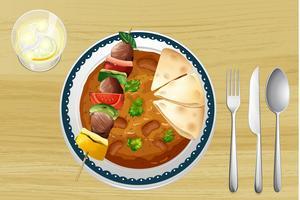 Une viande, un haricot au curry et un pain
