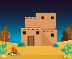 Une maison d'adobe au désert vecteur
