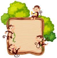 Singe sur une planche de bois vecteur