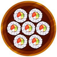 Une vue de dessus des sushis à la table vecteur