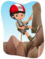 Garçon escaladant la montagne