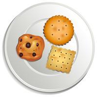 Une assiette avec des biscuits vecteur