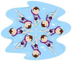 Femme nage synchronisée en groupe