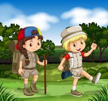 Garçon et fille de randonnée dans le parc vecteur
