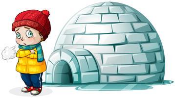 Garçon debout devant l'igloo vecteur