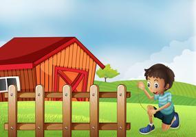 Un garçon tenant une corde à la ferme