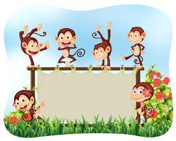 Cadre en bois avec des singes