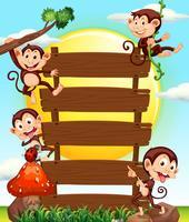 Panneau en bois et quatre singes vecteur
