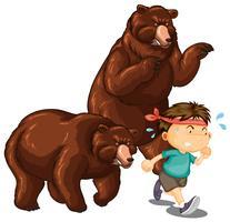 Deux ours chassant un petit garçon vecteur