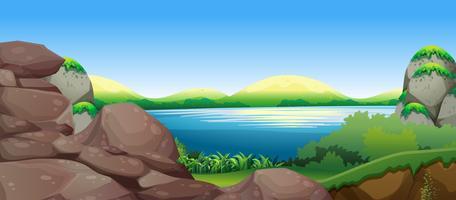 Scène de la nature avec lac et collines