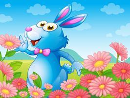 Un lapin avec des fleurs dans le jardin