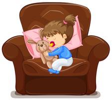 Enfant dormant sur un fauteuil