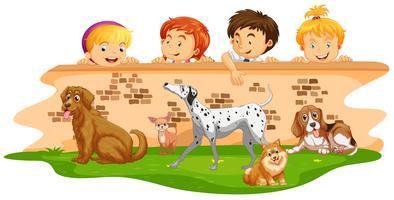 Enfants regardant des chiens par-dessus le mur vecteur