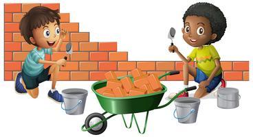 Deux garçons construisant des briques ensemble vecteur