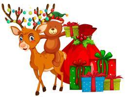 Thème de Noël avec des rennes et des cadeaux vecteur