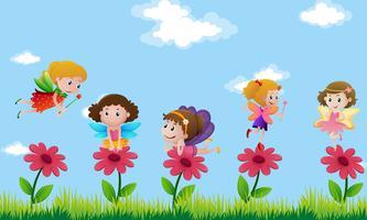 Fées volant dans un jardin de fleurs