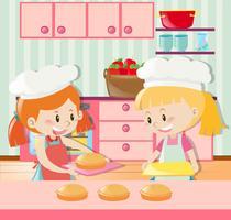 Deux filles font la tarte dans la cuisine